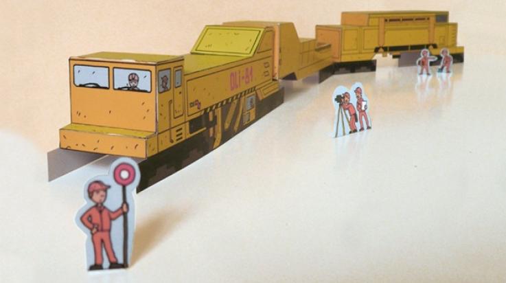 Eine Gleisbaumaschine aus Papier; Bild: Titus Ackermann