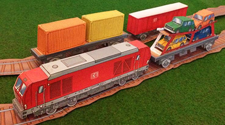 Bastelspaß: Ein Güterzug mit Container- und Autotransportwagen und Schienen dazu; Bild: DB AG